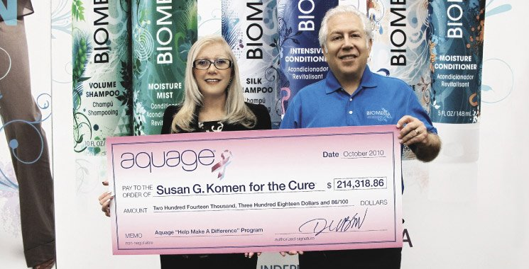Louis Alvarez presenting check to the Susan G. Komen Foundation
